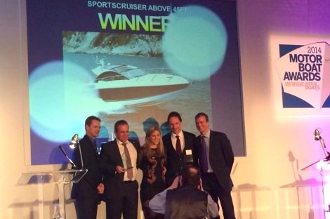 "The Sunseeker International team, including Sales Director Sean Robertson (2nd from L), collect the award for ""best sportscruiser over 45ft"" won by the San Remo"