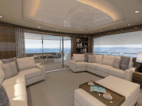 Plentiful seating and expansive glazing in the Saloon of the 86 Yacht creates a welcoming and comfortable space for relaxing and entertaining onboard