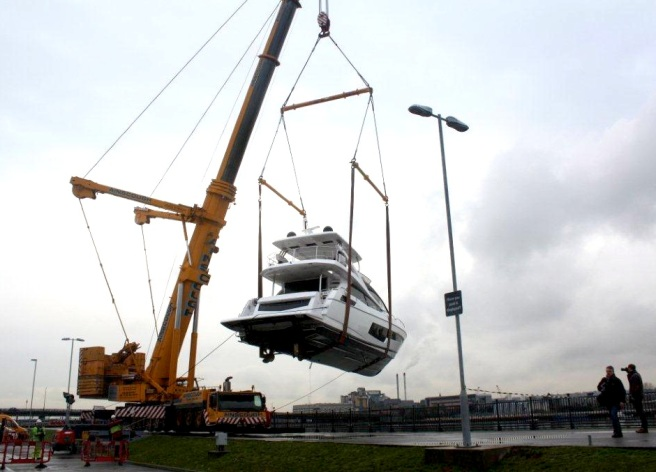 The Sunseeker 75 Yacht creates a stir near Docklands as she is craned into the water for her final part of her journey