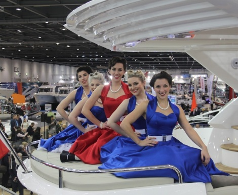 Elle & The Pocket Belles strike a pose on board the Sunseeker Manhattan 55 at the London Boat Show