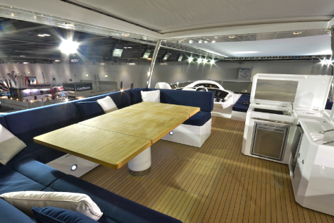 The expansive 80 Yacht flybridge features a reclining GRP hard-top