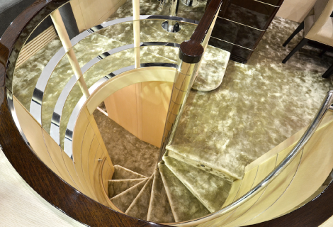 Round and round she goes: The spiral staircase is an inspiring piece of interior design onboard the 75 Yacht