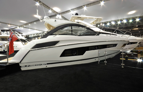 A deal for the Sunseeker Portofino 40 was agreed and signed by Jamie Coombes on the London Boat Show Sunseeker stand