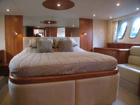 """Cherry satin interiors on board the Predator 62 """"REEF"""" compliments cream furnishes and linings beautifully"""