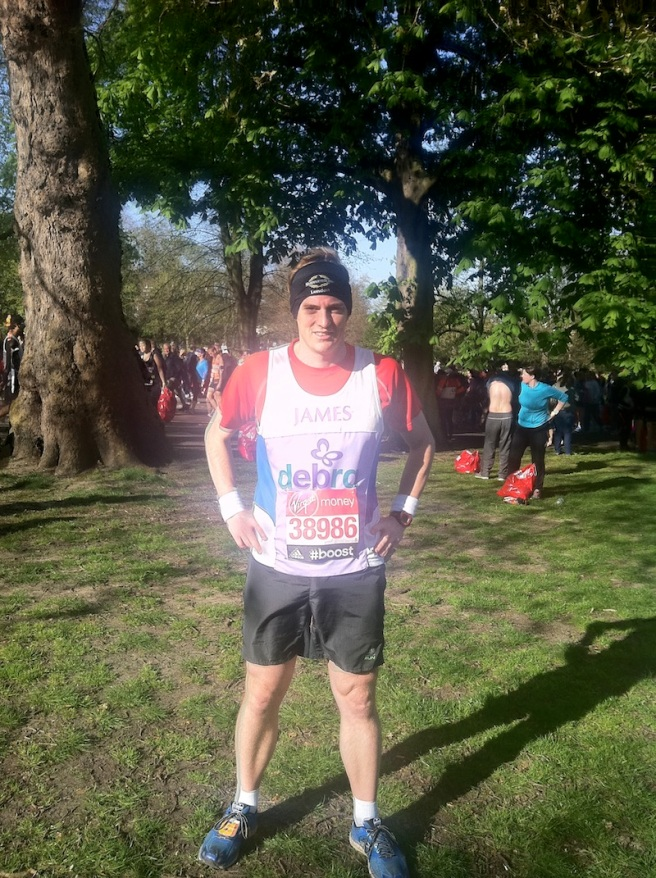 James Baker dons his DEBRA charity vest and Sunseeker London bandana ahead of Sunday's London Marathon