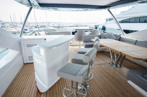 The wet bar is a great addition to the flybridge area, which also features a carbon fibre sliding hard top