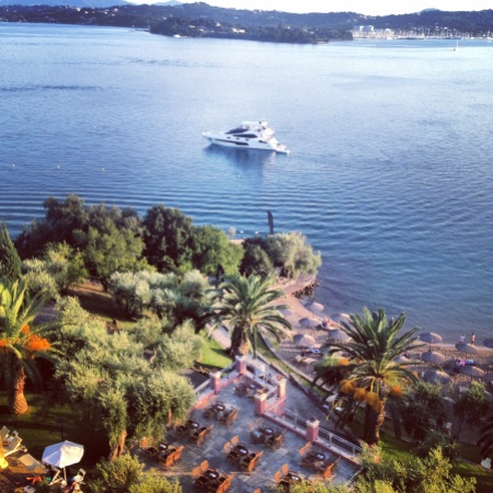 """The 75 Yacht """"FINEZZA"""" pictured the morning of the event, with beautifully still waters and the stunning Corfu Imperial Hotel nearby"""
