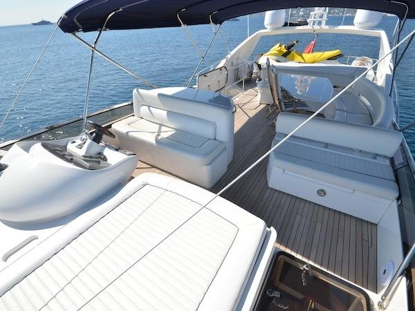 "The flybridge of the 75 Yacht ""SOMETHING DIFFERENT"" houses a jet ski, in addition to providing comfortable exterior areas, secondary helm and full wet bar"