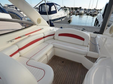 "Providing ample exterior space in the cockpit and helm area, the Superhawk 34 ""TOY BOX"" boasts well-maintained upholstery"