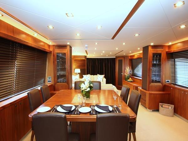 The Saloon features plenty of comfortable seating, with a large dining area for guests onboard