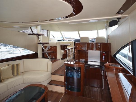 Cherry gloss interior, classic cream leather upholstery, generous and comfortable accommodation, the Fairline Squadron 58 is a luxurious vessel