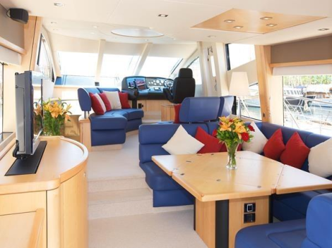 """With light wood finishes and deep blue Saloon upholstery, the interiors of """"RAOUL W"""" are eye catching and modern"""