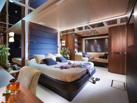 The 101 Sport Yacht accommodates up to 8 guests in 4 cabins, with an additional lower deck office area