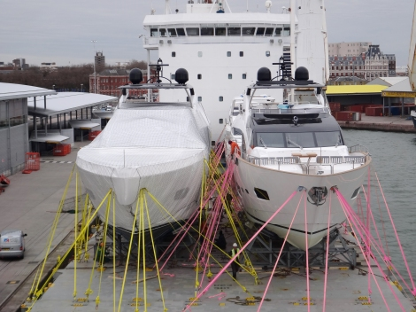 A Sunseeker 28 Metre Yacht being delivered by Peters & May with the special BCCT Pink Lashings