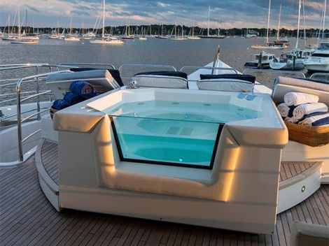 """The 130 Sport Yacht """"NEVER SAY NEVER"""" boasts copious entertaining areas including the sports flybridge, complete with retracting hard top and jacuzzi"""