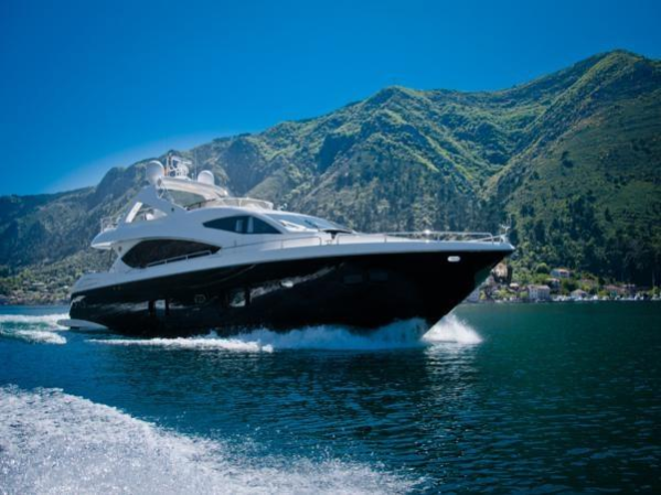 """Featuring a black hull and white superstructure, the 88 Yacht """"OOMKA"""" cuts a striking image through the water"""