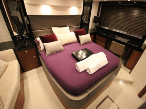 The lower deck boasts 3 cabins and 2 bathrooms with a satin black American Walnut finish
