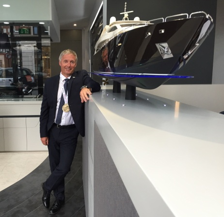 Christopher Head at Sunseeker London Group Headquarters in Mayfair, London with his winning medal