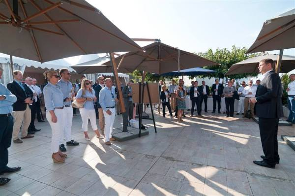 On the exclusive VIP terrace of the Palais des Festivals, overlooking the Cannes Yachting Festival, guests were welcomed with a special edition 100 x 100 commemorative Champagne flute filled will the finest Champagne