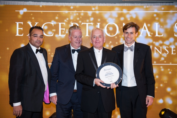 Guy Bosmans and Denis Bosmans from Sunseeker Ibiza accept the prestigious award for Exceptional Service Support from Sunseeker International Founder, Robert Braithwaite CBE DL
