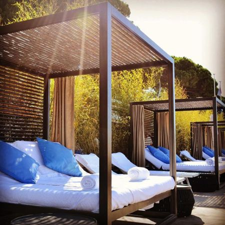 Relaxing sun beds at the Grand Hyatt Cannes Hotel Martinez