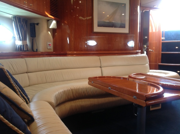 This beautiful boat has the timeless and highly sort after Cherry Gloss wood with cream leather sofas and chairs