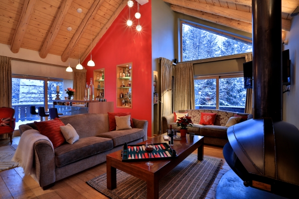 Fully stocked bar and entrainment space available for guest to enjoy at Chalet Arolla
