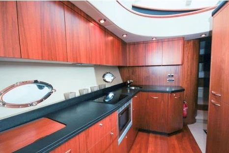 The spacious galley is has close boarded Teak flooring and is equipped with a dishwasher & washer - dryer.