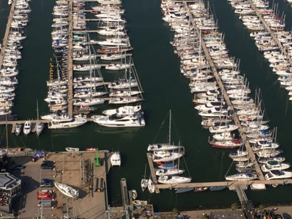 Aerial shot of Lymington Marina, where the 75 Yacht 'HARD 8' can be seen in the foreground