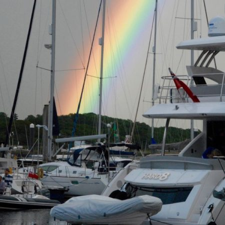 A rainbow shining over 'HARD 8' in Lymington Yacht Haven.