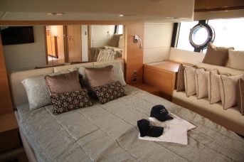 The interior of the Portofino 48 is warm and modern and...