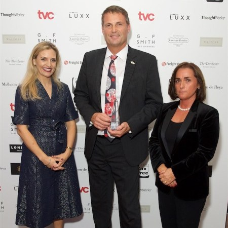 Phil Popham CEO of Sunseeker with the award for Champion of British Luxury Manufacturing, In association with G.F Smith Papers and presented by Sarah Anderson