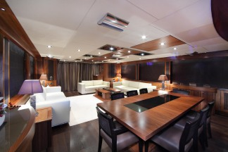 The warm furnishings of the Saloon give visators a welcoming feel to the Yacht