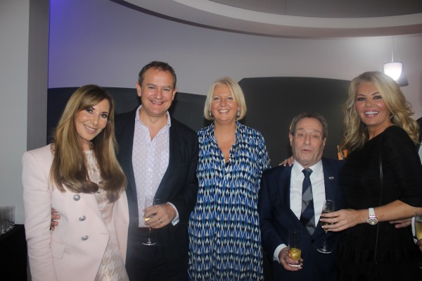 Alexis Lewis, Hugh and Lulu Bonneville, David Lewis and Claire Caudwell pause for a photo at the Sunseeker London Christmas Party