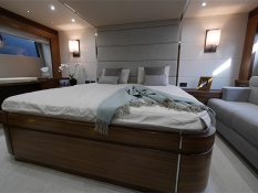 The master bed room on the 68 Sport Yacht is perfectly designed to be spacious and homely