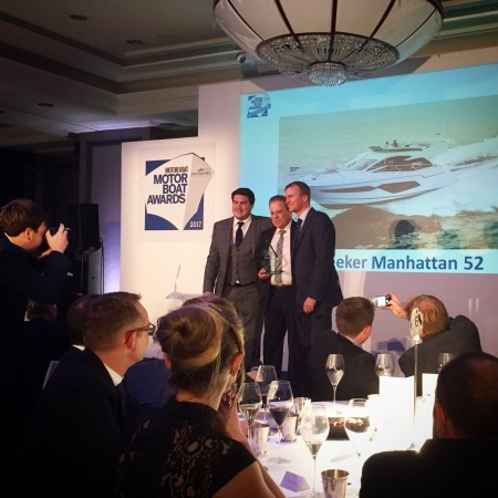Sean Roberston, Sales Director of Sunseeker International collecting the award for the Manhattan 52