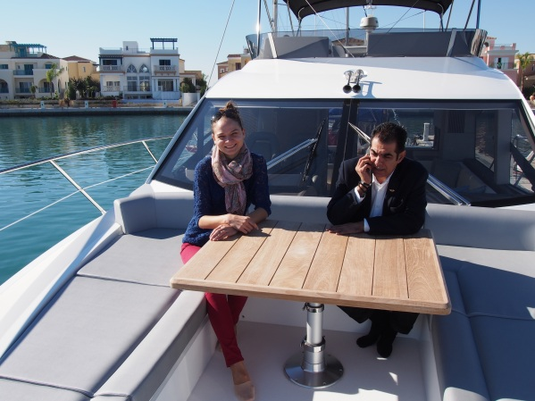 Sunseeker Cyprus team members Evros and Katerina enjoying the Cyprian Sun while on the Manhattan 52's spacious Fore deck