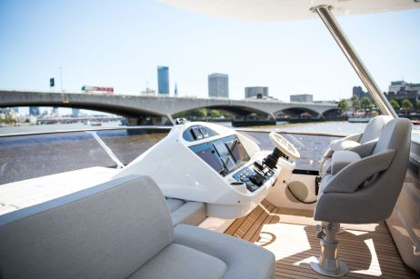 Driving from the flybrige on a beautiful sunny day, creates the most perfect yachting moments