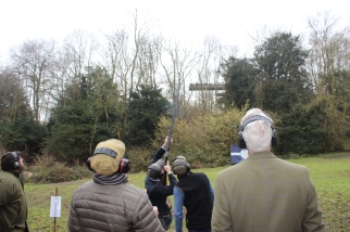 Not being able to look away, spectators watch as one of the finalists has their go at the final shoot
