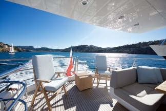 The flybridge of the Sunseeker 75 Yacht is the perfect place to relax out at sea and enjoy picturesque views