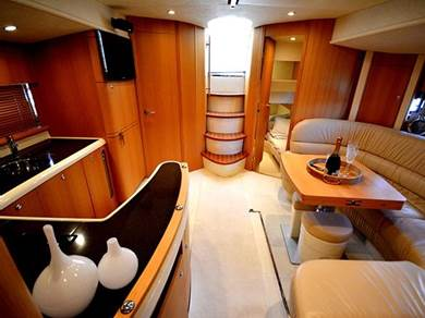 The saloon/galley oozes luxury with upgraded leather upholstery and satin oak finish.