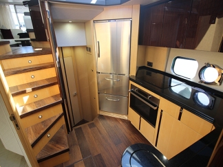 She is finished with a modern wood interior and has a sleek and appealing exterior