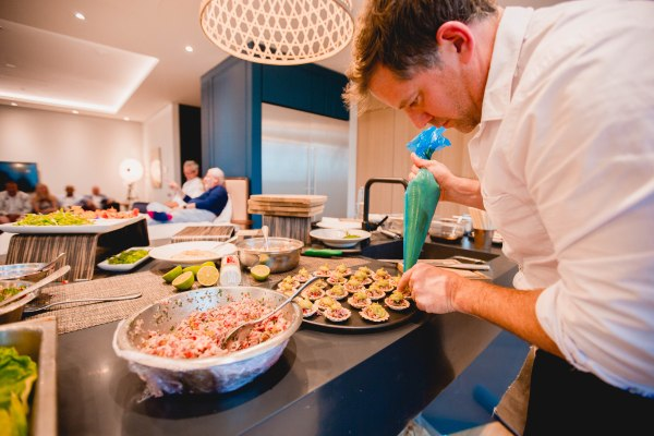 Matt Tebbutt piping a scrumptious mousse onto his delightful canapés